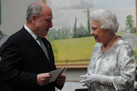 Queen Elizabeth II talks with music promoter Harvey Goldsmith (left) after presenting him with a Diamond Award for his contribution to British culture during a Diamond Jubilee celebration of the arts at the Royal Academy of Arts in central London.